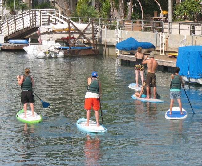 Paddleboarders on a Naples canal