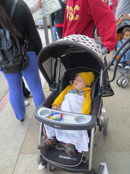 Sleeping baby at New Year's parade