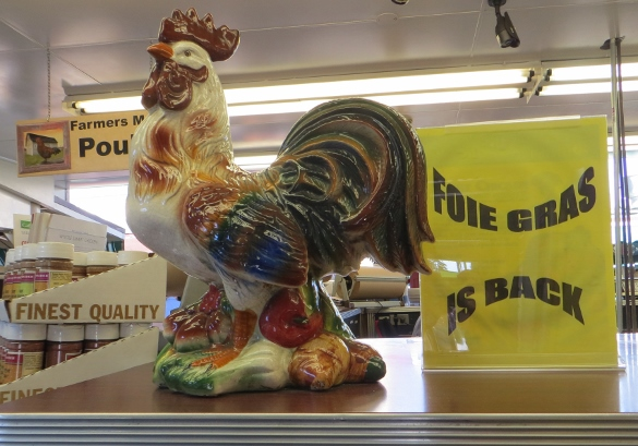 A couple of years ago thanks to the efforts of the PETA people foie gras was banned in California, but that ban was reversed.  But why this shop was showing a French ceramic rooster next to their sign I do not know. Faoie gras is from geese.