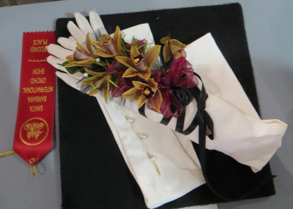 Long white gloves with orchid corsage.