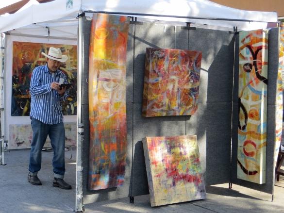 Artist setting up booth at Burbank Fair