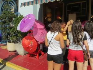 umbrellas and shorts at Chinese New Year parade