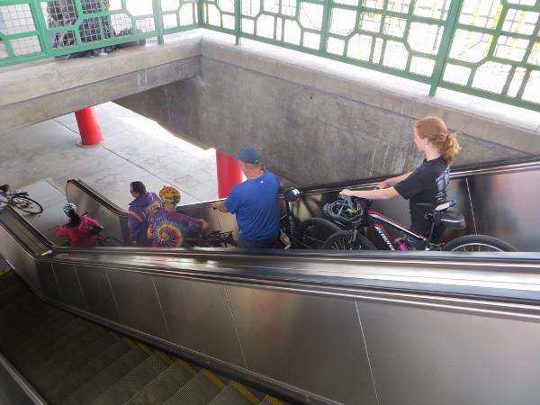 cyclists on metro escalator