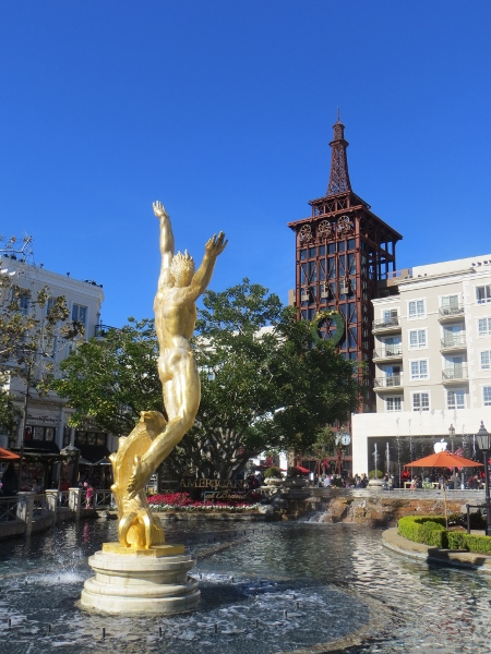 gold plated statue americana