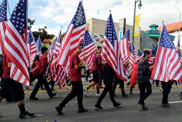 The Chinese Historical  Society of Southern California ALWAYS comes at the head of the parade (behind the motorcycle police).  Unlike previous years, the men and women carrying the flags were young.  In other years most had gray hair. These must be the grandchildren!