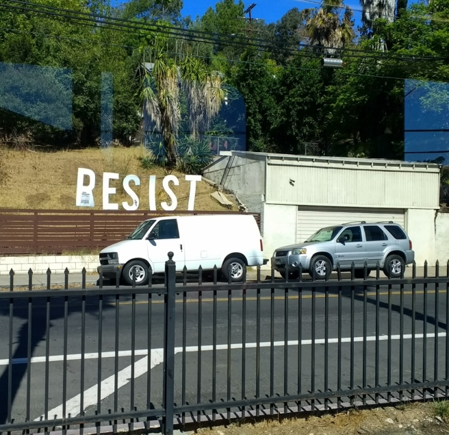 Resist sign along Gold Line