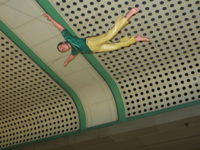 Civic Center station flying man
