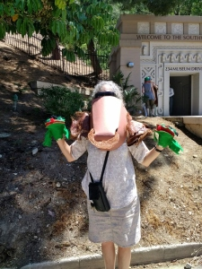 Marcher with puppets Lummis Days 2018