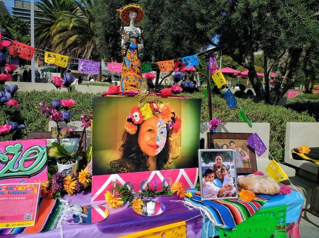 Face-painted girl family altar Los Angeles 2018
