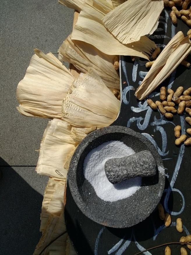Peanuts, salt and corn husks on Dia de los Muertos altar Grand Park